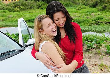 two happy women on car trip