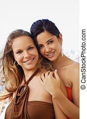 two happy women smiling at camera