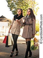 Two happy women walking