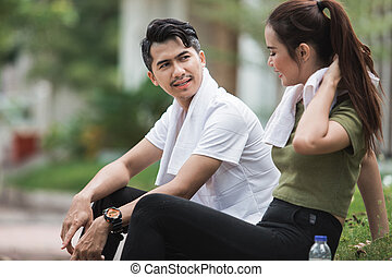 sport people sitting after exercising