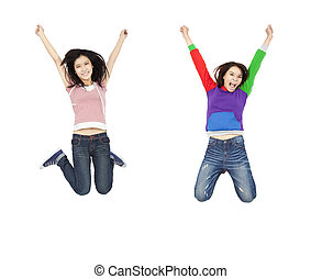 two happy young asian woman jumping with hands up