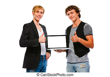 Two happy young men showing laptops blank screen. Isolated on wh