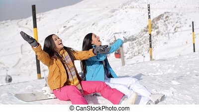 Two happy young women enjoying a winter holiday