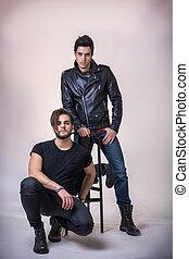 Two hard rock men posing in studio.
