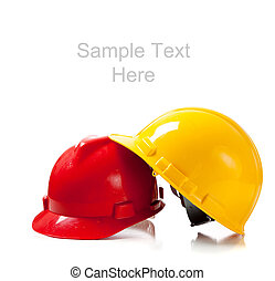 Two hardhats on white background with copy space