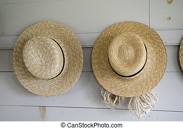 Two Hats Hanging - Close Up Of Two Straw Hats Hanging on...