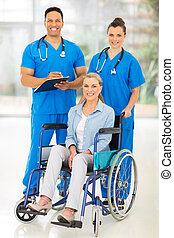 two health care workers and disabled patient