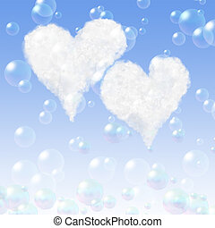 Two heart clouds on a blue background with soap bubbles