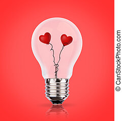 Two heart in light bulb