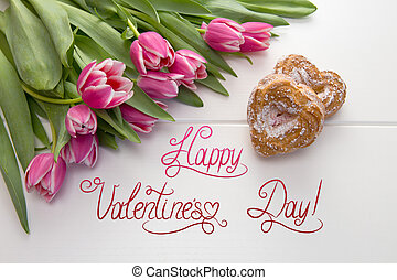 Two heart shaped cake and a bouquet of tulips .Valentines day card.