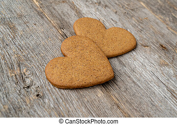 Two heart shaped gingerbread cookies