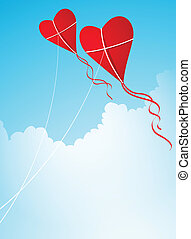 two heart-shaped kites in the sky