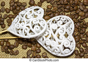 two hearts and coffee beans on sackcloth