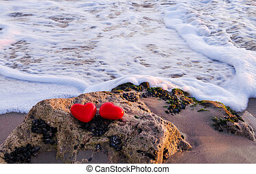 Two hearts by the ocean