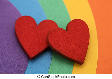 Two hearts on a colorful rainbow background