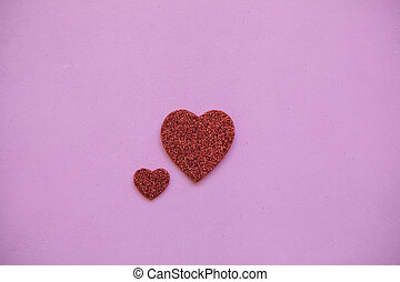 Two hearts on a pink background.