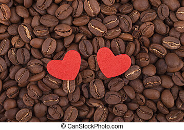 Two hearts on coffee beans.