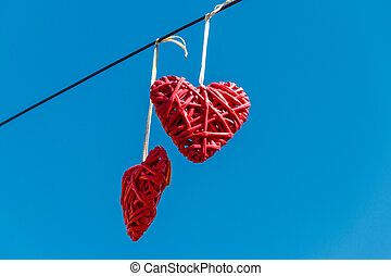 Two hearts on the background of blue sky