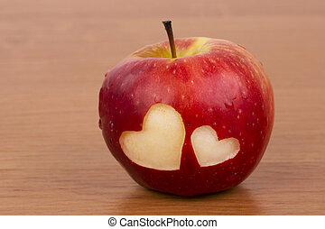 Two hearts on the fresh apple
