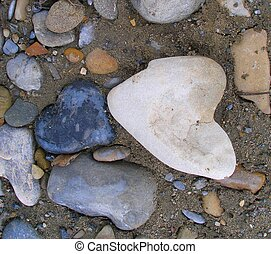 Two rocks shaped like hearts found together on a river bank.