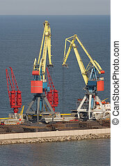 Two heavy cranes working in the port