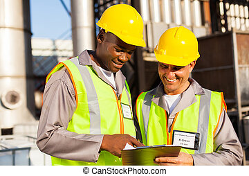 heavy industry workers working in plant - two heavy industry...