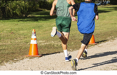 Two high school boys running a cross country race