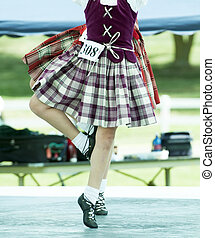 highland dancers - two highland dancers competing executing...