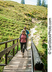 Two hiker on a wooden bridge