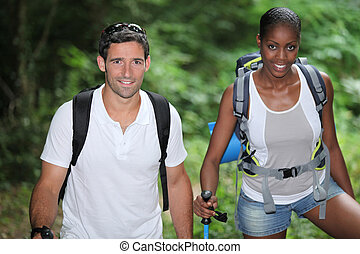 Two hikers in the woods