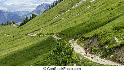 Two hikers walking in the mountains