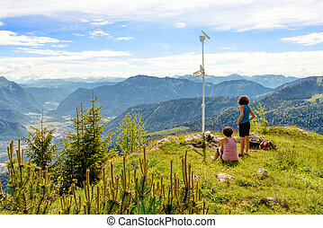 Two hikers women walking in the mountains