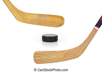 Two hockey sticks and puck