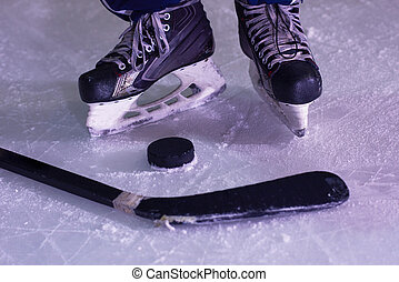 two hockey sticsk and puck on ice, start of the game, competition concept in business, top view