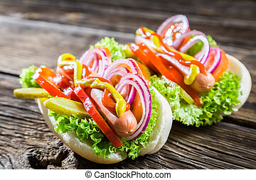 Two  homemade hot dog with fresh vegetables