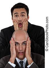Two horrified businessmen