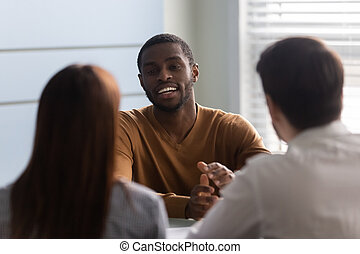 Two hr managers holding job interview with african american applicant.