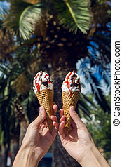 two ice cream cones with chocolate and jam