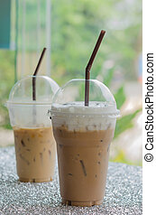 Iced coffee - two Iced coffee with straw in plastic cup for...