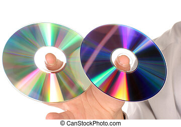 hand holding two cds on white