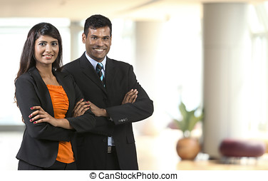Two Indian Business People. - Two Indian Business People...