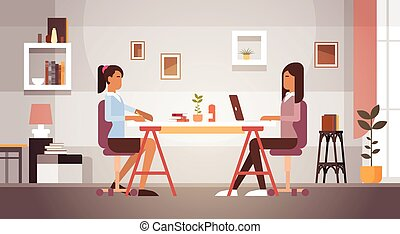 Two Indian Business Woman Sitting Desk Working Laptop...
