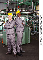 two industrial workers full length portrait