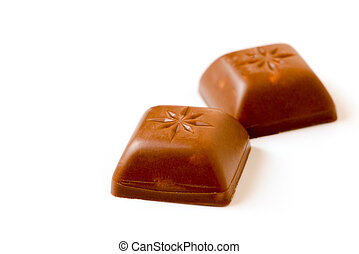 Two isolated pieces of chocolate