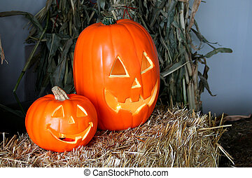 jack-o-lanterns - two jack-o-lanterns on a bale of straw