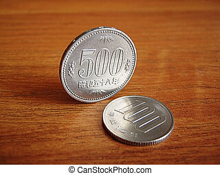 Photo of two Japanese coins in the 100 and 500 yen.