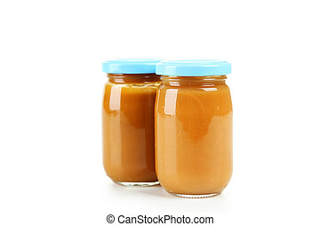 Two jars of baby puree isolated on white