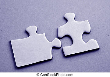 Two jigsaw puzzle pieces fitting together
