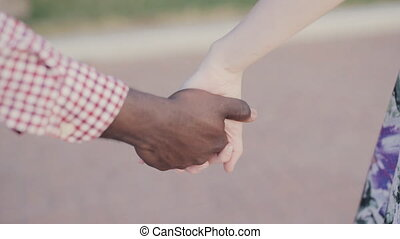 two joining hands, International friendship theme - two...