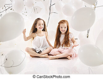 Two joyful girls playing together